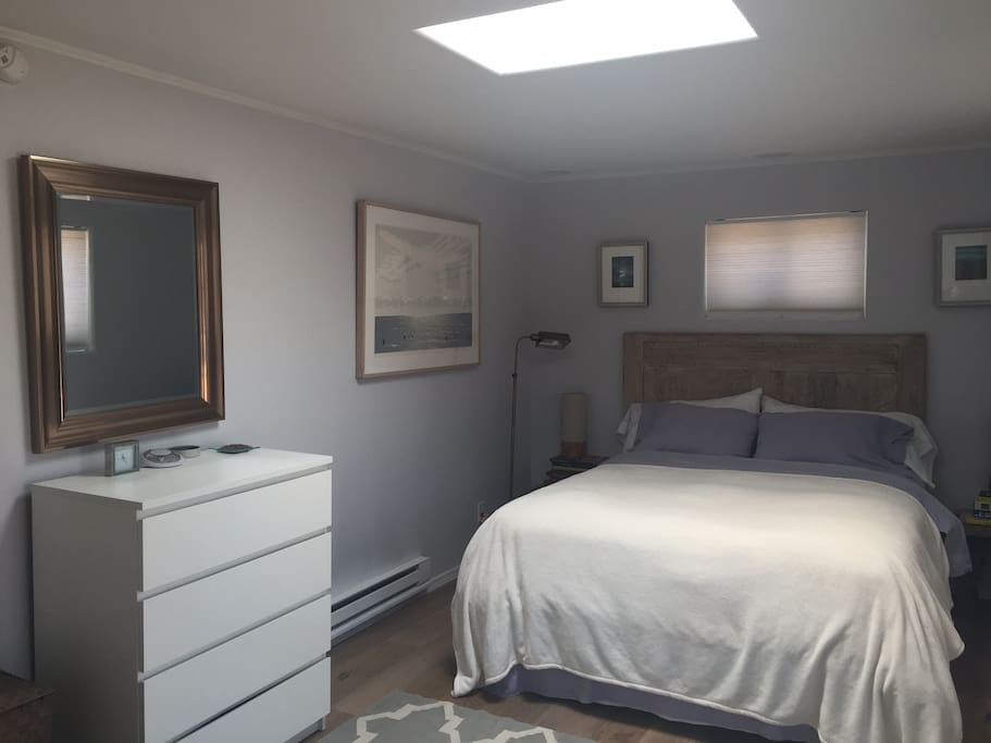 Renovated Master bedroom with queen-sized bed, skylight and its own private bathroom w/ deep, 6-ft tub.