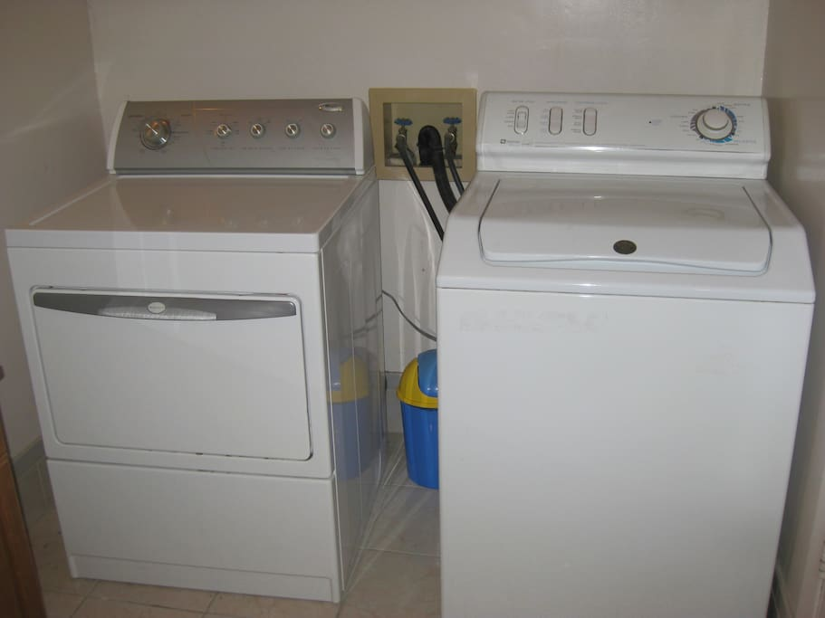 washer and dryer in right side of bathroom