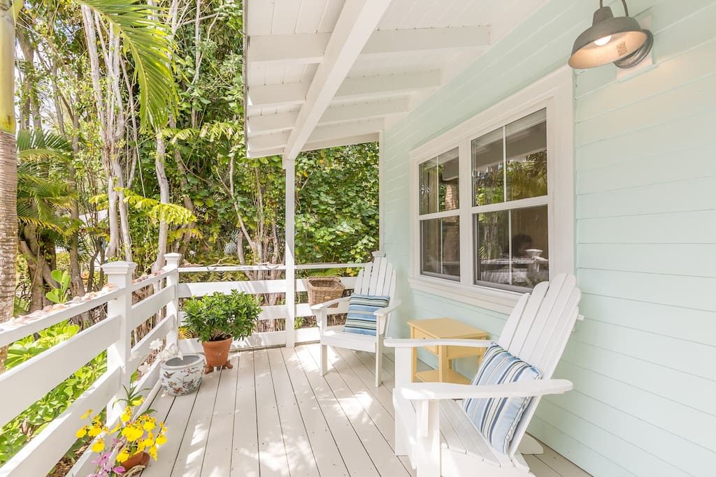Relax on the front porch with matching Adirondack chairs