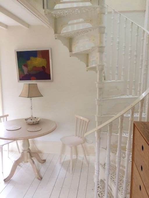 Spiral staircase to upstairs suite