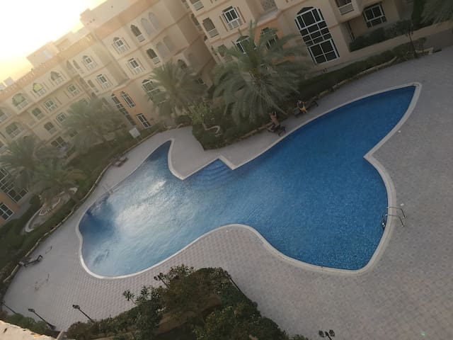 A swimming pool view room