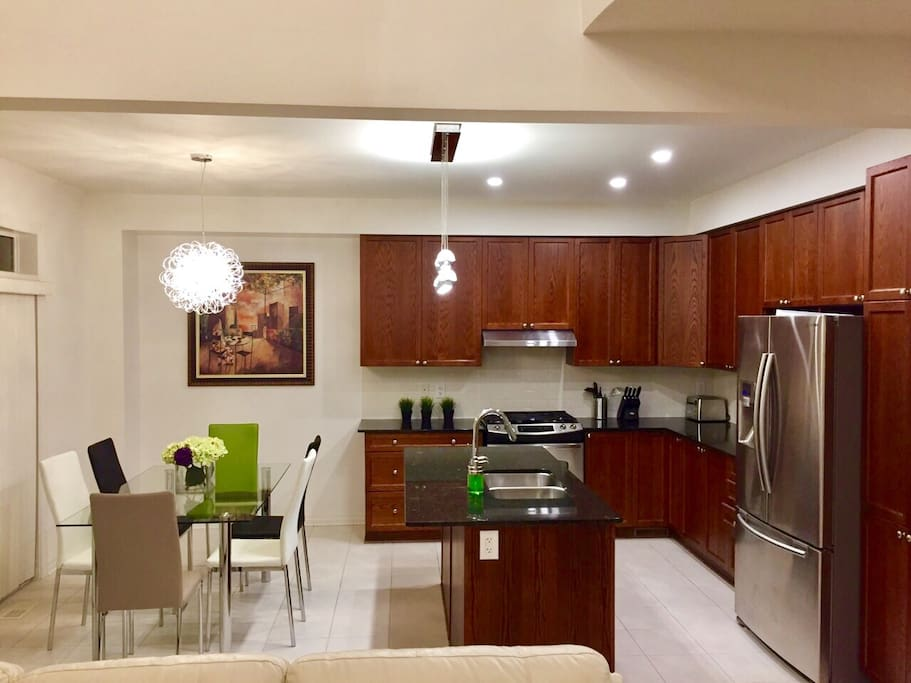 Kitchen with dining table/stainless appliances