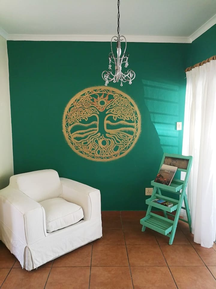 Living Room with Tree of Life Wall Painting