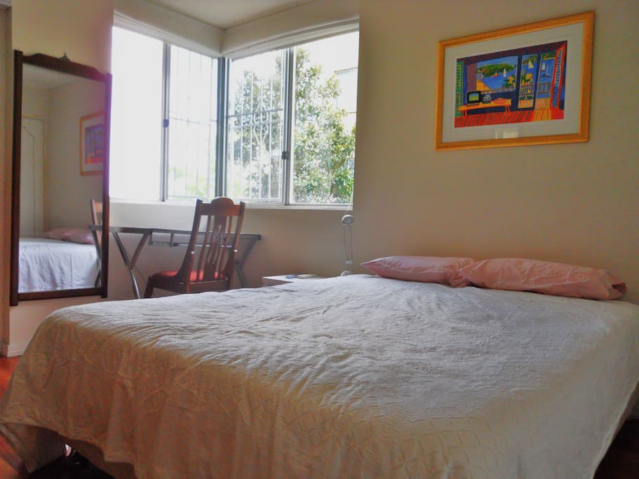 Spacious ensuited bedroom with queen sized bed and river views