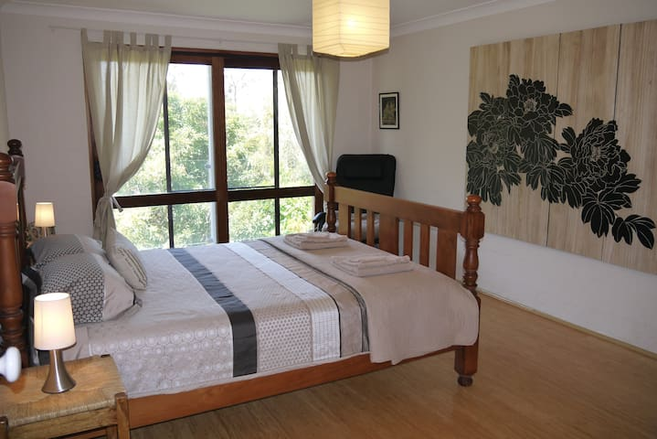 Master bedroom with bush and ocean views
