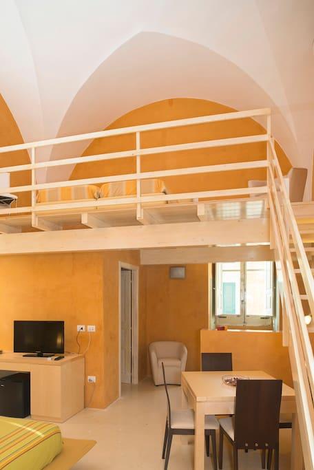 Soppalco Camera Deluxe con balcone e vasca idromassaggio Jacuzzi