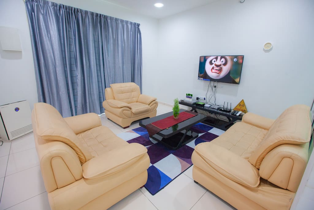 """Living Room entertaining by 49"""" 4K LED TV, satellite channel, Internet TV programs all day long, DVD player and wifi."""