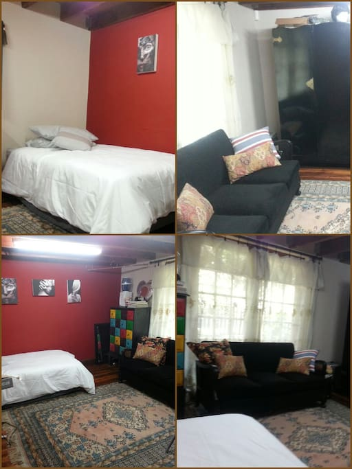 3/4 bed in cosy room with couch and cupbourds