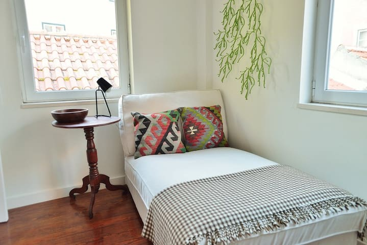 The chaise longue in the bedroom is perfect for an afternoon nap.