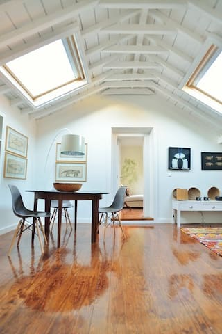 The living room with amazonian art on the walls.