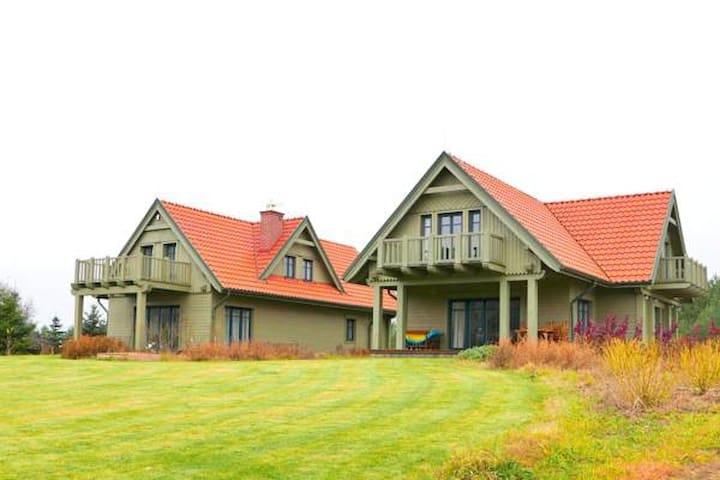 Wnukowo - mazurskie domy nad Jeziorem Roś