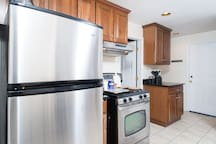 modern kitchen with plenty of cabinet space. feel free to use the fridge, toaster oven, or microwave