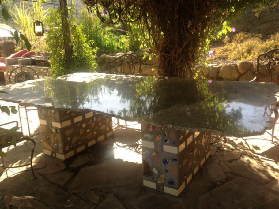 Gorgeous hand made outdoor dinning under the stars, very cool Granite table.