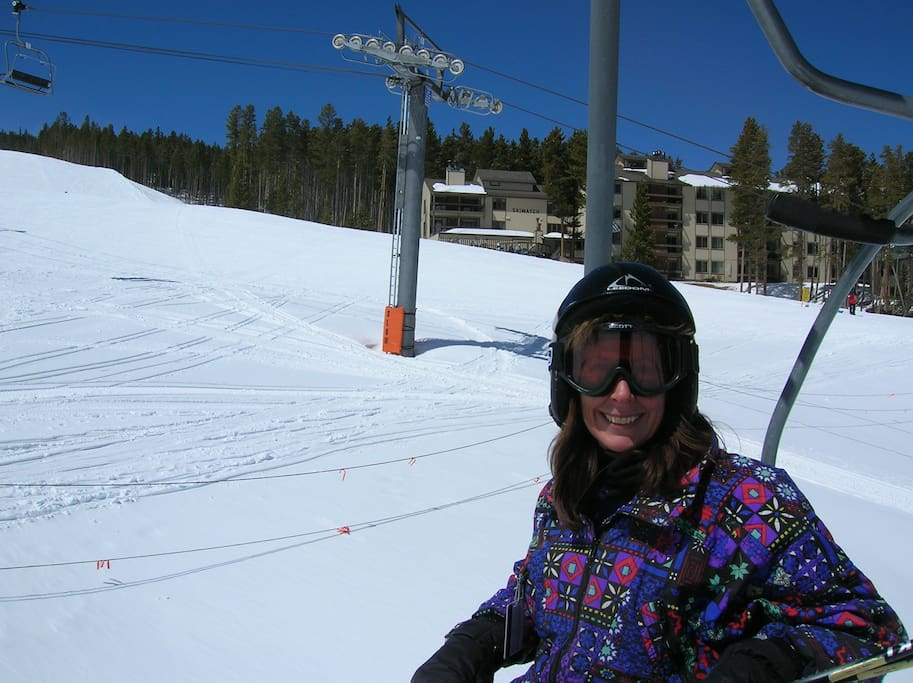 Owner (Ruth) on chairlift with Skiwatch in the background!