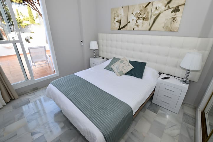 Main bedroom with access to private sun terrace.