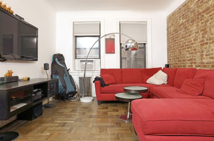 Large Living Room with Exposed Brick Wall