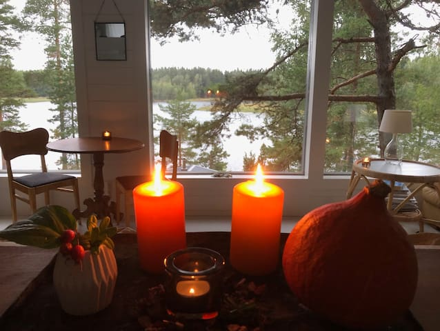 Autumn time, gray and  day out but cosy candle light inside