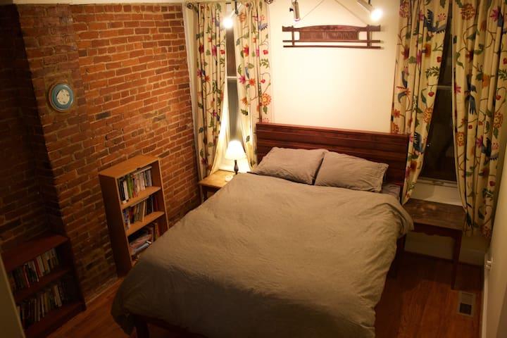 Master bedroom - cozy with exposed brick!  Queen bed.
