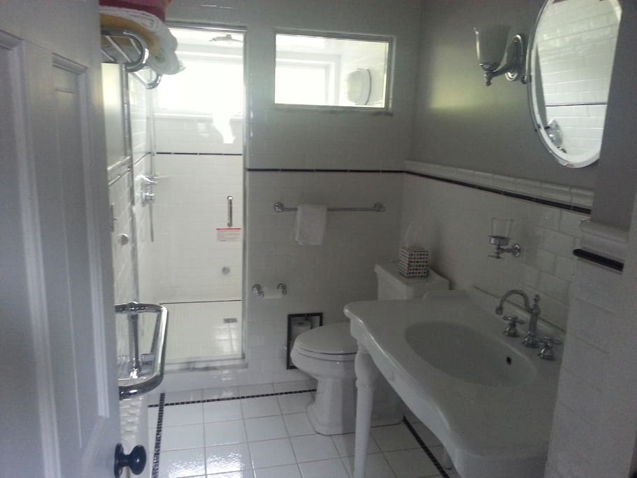 Shared bathroom with steam room