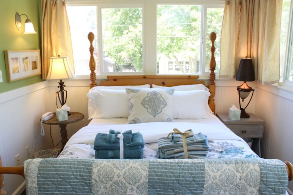 A bundle of matching towels, color-coordinated to the room, is provided to each guest.