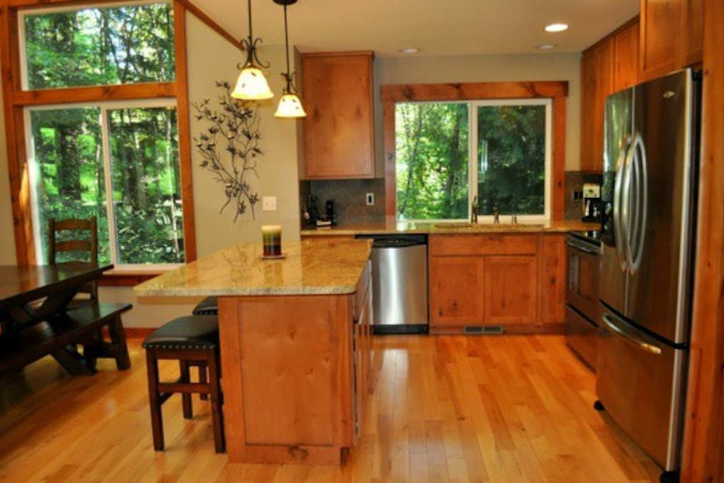 Fully stocked kitchen with microwave, refrigerator, electric range store, toaster oven and more!