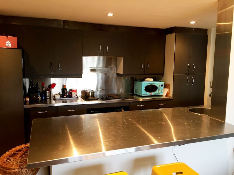Kitchen with stainless steal countertops