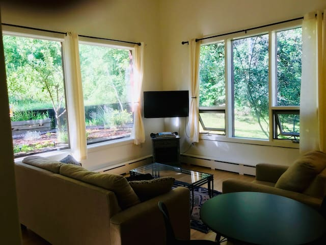 Living room with view of forest