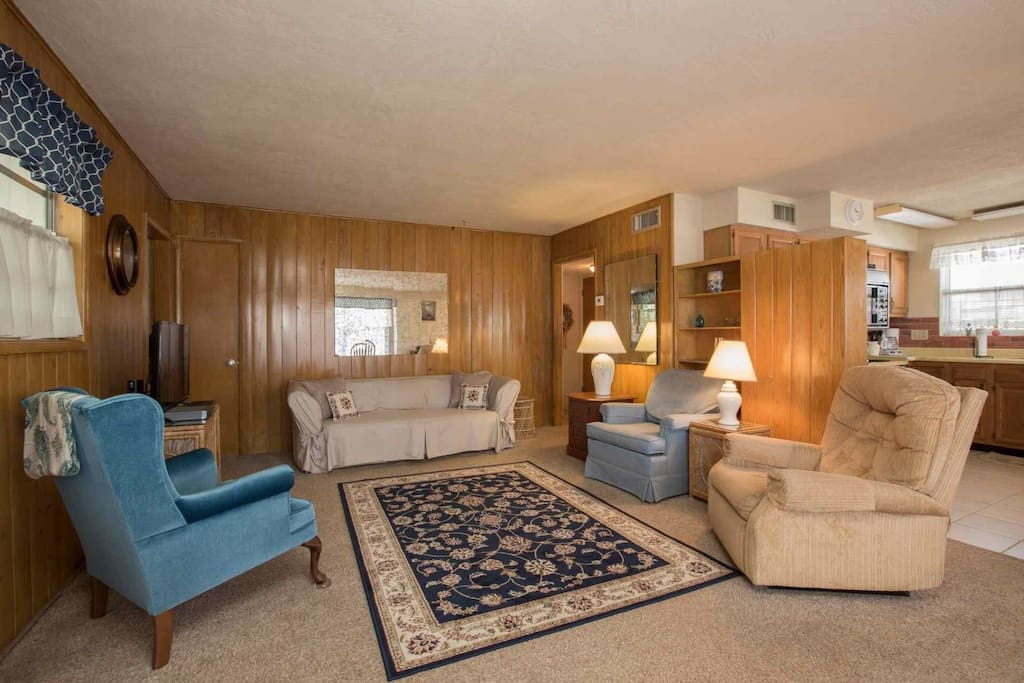 Large living room space connected to eat-in kitchen.