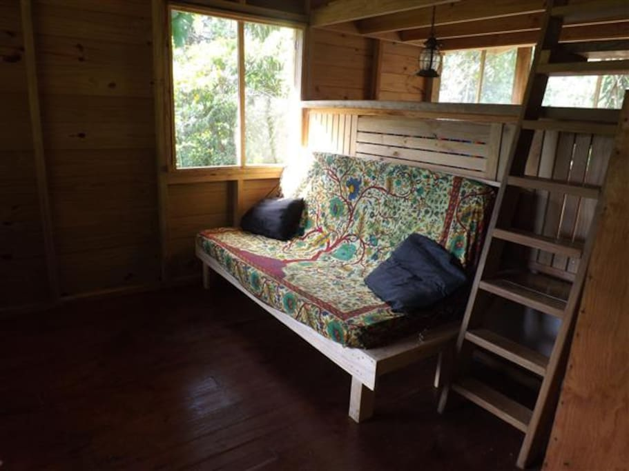 inside, a futon bed, custom made for the cabin, unfolds into a double bed