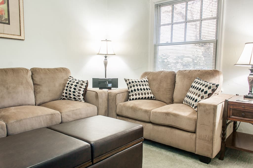 Comfy couch, love seat and ottoman that converts to a coffee table.