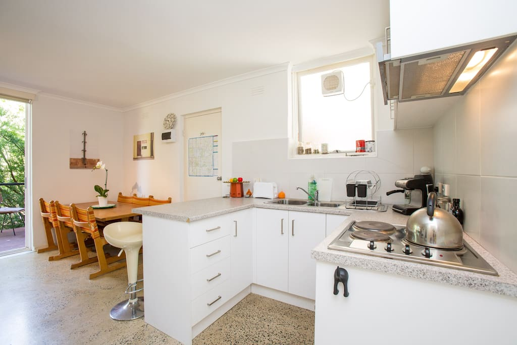 Modern kitchen adjacent to the dining area