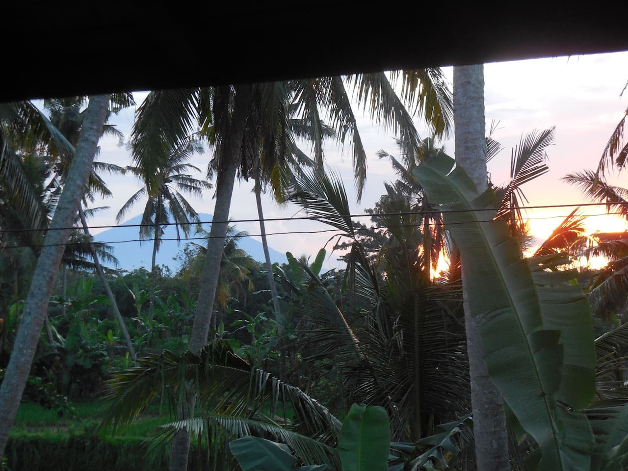 Sunrise from main bedroom with Mount Agung