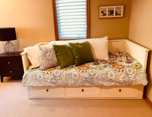 Guest bedroom-Queen trundle with lots of pillows and comfy bedding. Games and TV in this room. A nice spot for kids. Room to set up a pack-n-play for little ones too.