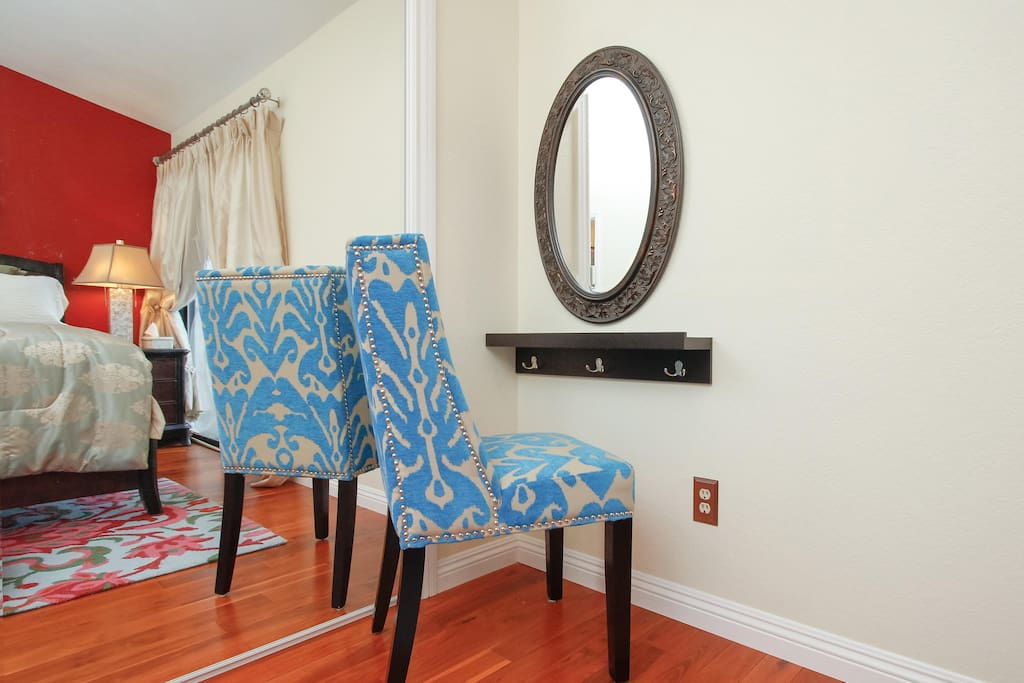 Small make-up area in the master bedroom and large wall sized sliding mirrors open to the closet.