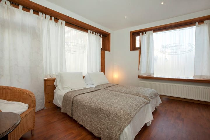 the guest room with big windows