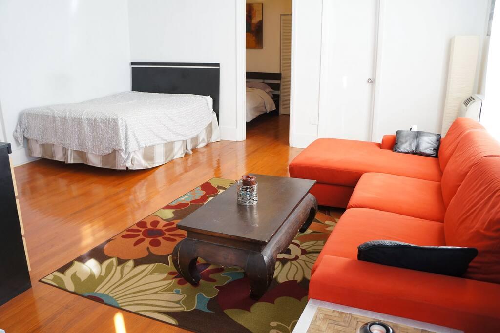Queen bed in corner of Living Room, Sleeps 2