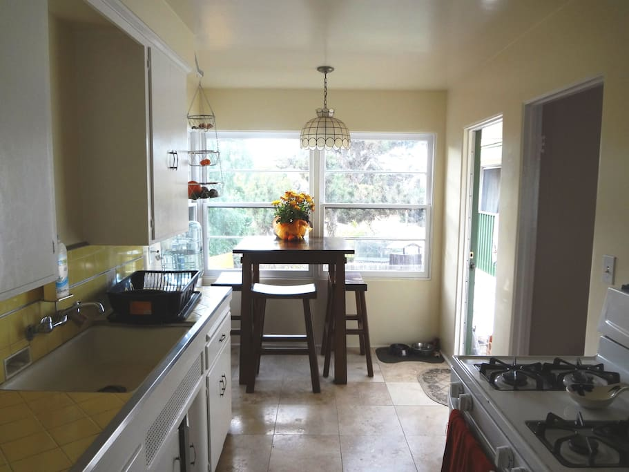 Eat-in kitchen with bright view of back yard.