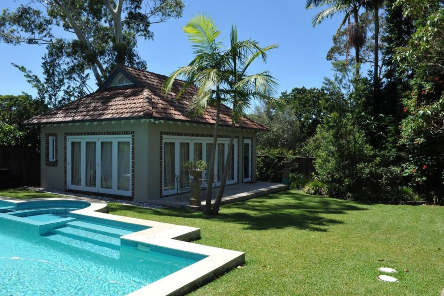 Cottage, pool and garden area.