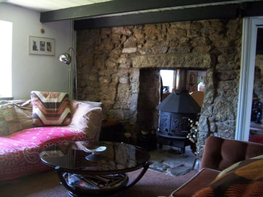 The wood burning stove can be opened from both sides and makes the rooms cosy and inviting.