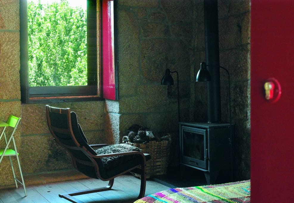 Enjoy a book by the fireplace in winter vacacion