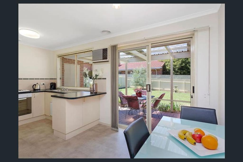 Kitchen with full size fridge, coffee machine and microwave