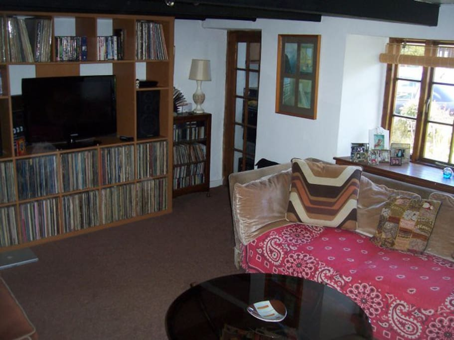 The living room has one comfortable sofa for an extra person.  A big TV screen with loads of DVD's.