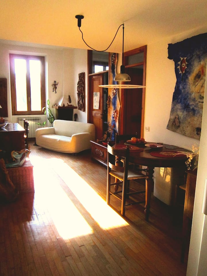 the sunny living room with the art works