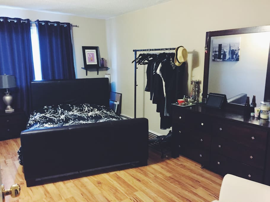 Bedroom - large Queen bed, spacious bedroom with hanging rack. Can accommodate an extra airbed for extra guests if necessary.