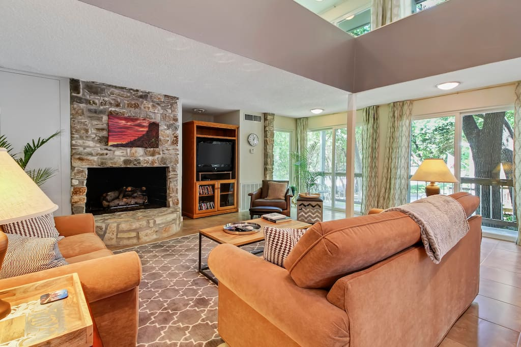 Living room with gas fireplace and queen size sofa bed