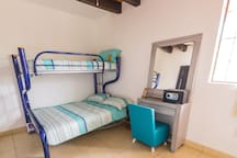 Bunk bed with 1 queen sized bed and 1 individual bed. Studio has it's own full bathroom and closet with dressing table.