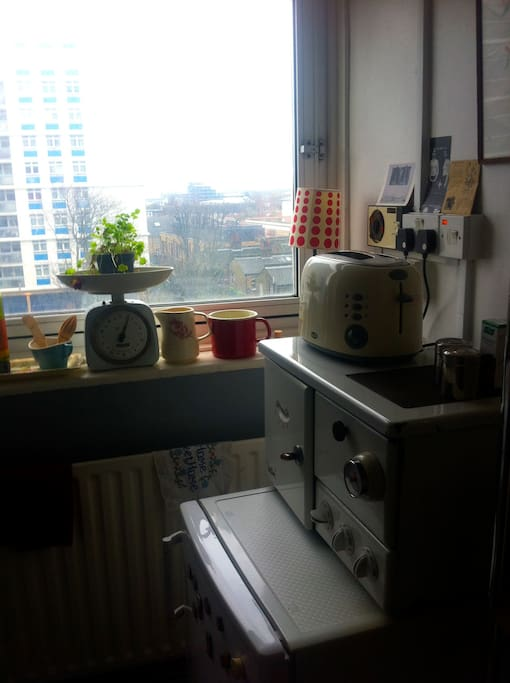 cute kitchen with washing machine and breadmaker.
