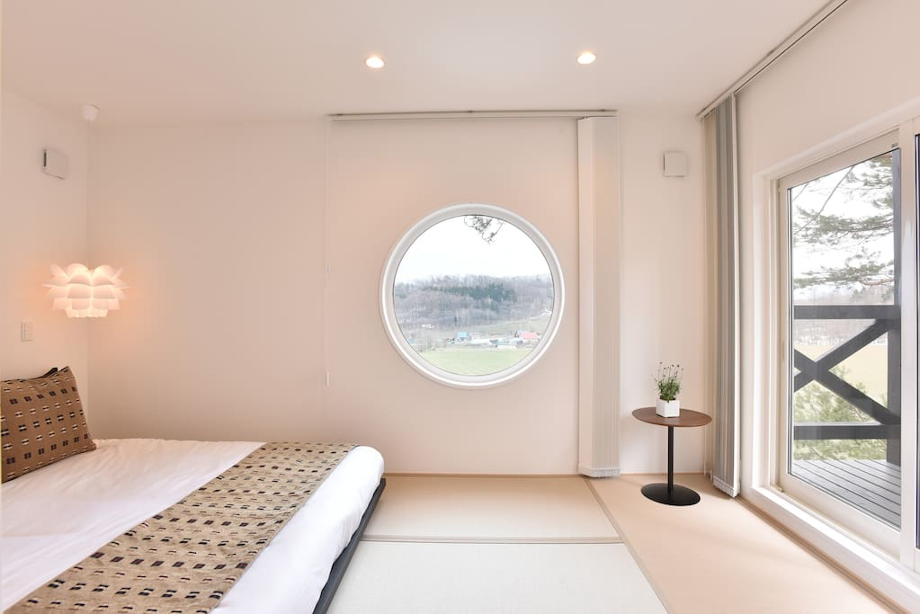 Bedroom features serene Japanese stylings and views of both our garden and the nearby Tokachi Peaks mountain range.
