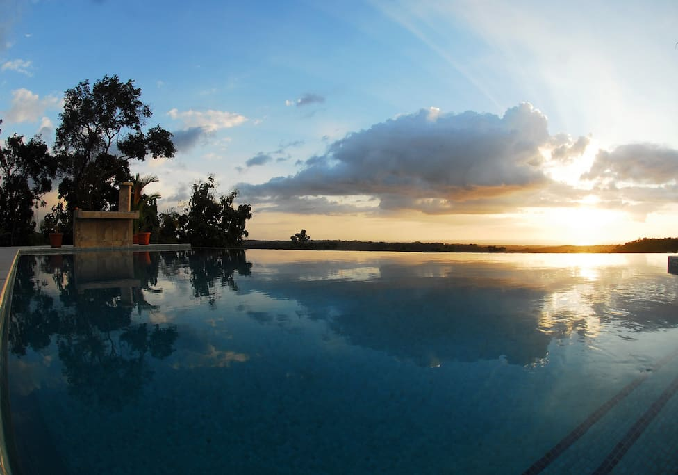 Enjoyt consistantly different sunsets each evening while lounging around the pool