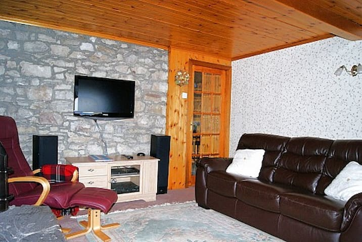The comfortable living room with woodburner